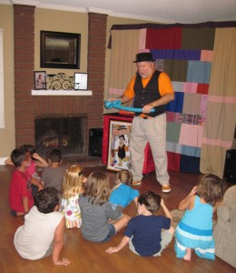 Children's Birthday Magician Mister Porkpie performing a show.