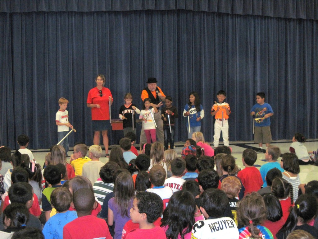 Southern California magician Mister Porkpie perfoming with many students.