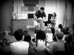 Mister Porkpie perfoming magic at a Riverside County Library.